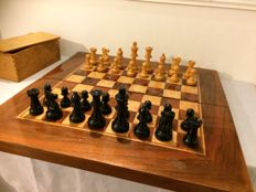 Large chess board of mahogany with large glazed chess pieces
