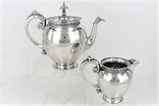 Silver teapot and milk jug with double pearl edge and fencing, van Kempen, 1900