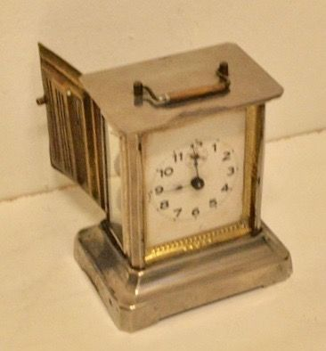 Empire style nickel alarm clock with music box, circa 1900.