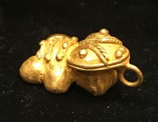 A South American Tumbaga Gold, Colombia,  Tairona figure  27 x 13 x 18 mm , 8,5  grams, A pendant of a frog