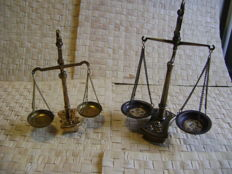 2 gold scales with weights
