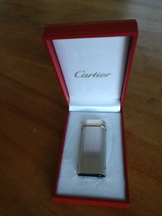 Cartier lighter, brushed steel with golden wrapping late 1990s