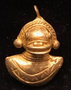 A South American Tumbaga Gold, Colombia,  Tairona figure  28 x 23 x 15 mm , 7,1 grams, A pendant of an Indian native amulet