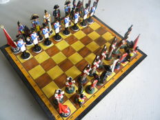 Chess game in handcrafted melted pewter and hand painted.