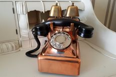 Antique copper telephone with 2 bells