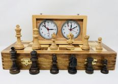 Old oak chess with board and clock