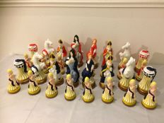 Curious chess set in plaster depicting Louis XIV