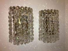 J&L Lobmeyr - pair of brass wall lights, crystal tassels