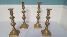 Two pairs of antique candlestiks