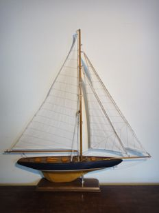 Sailing yacht - beautiful slim shape - wooden sailing boat