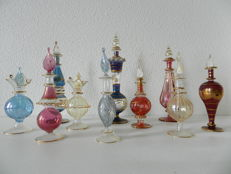 A collection of 10 Oriental perfume bottles - glass