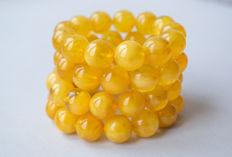 Two Baltic Amber bracelets, 100% egg yolk colour, total 69 grams