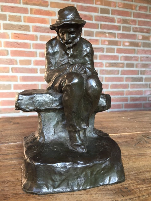 Bronzed metal sculpture of a lonely man on a bench - signed by Marcel Début - France - early 20th century