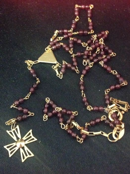 18 kt gold rosary cross and garnets