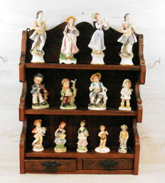 Wall cabinet with porcelain figurines