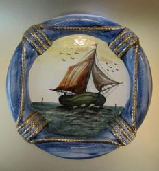 Majolica wall sign with a painted sailing ship in a buoy