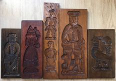 Five vintage hand-carved gingerbread boards