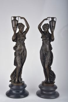 "Two beautiful large bronze sculptures ""woman with chalice"" to A. Carrier, Belgium / France, 20th century"