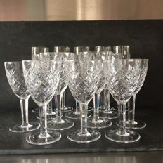 15 (5 flutes + 5 water glasses + 5 wine glasses) in fine crystal