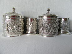 Two beautifully decorated silver plated boxes and two silver plated spoon vases from Herman Hooijkaas.