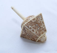 A carved bone spinning top or Dreidel - Hannukah - Austria - first quarter 20th century