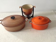 LE CREUSET - 1 large and 1 small cooking pot and 1 fondue set.