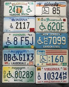 A Lot with 10 Disabled/Handicapped wheelchair drivers license plates.