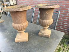 2 old cast iron vases