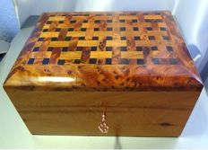 Fine carved mahogany box with interlaced and polished wooden lid.