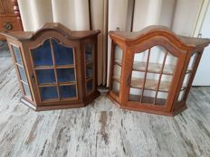 Two oak hanging display cabinets