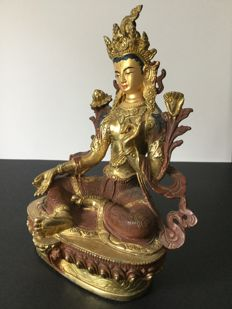 Representation of Green Bodhisattva Tara in copper with gold and brown patina – Nepal – late 20th century.