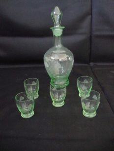 Liquor decanter with 5 glasses - worked green translucent glass - 1940
