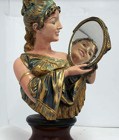 "Large statue titled ""Dama allo specchio"" on wooden base"