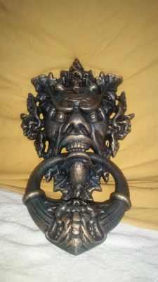 A cast iron door knocker
