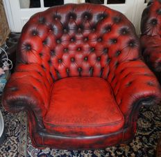 Chesterfield style, red leather padded armchair for one person