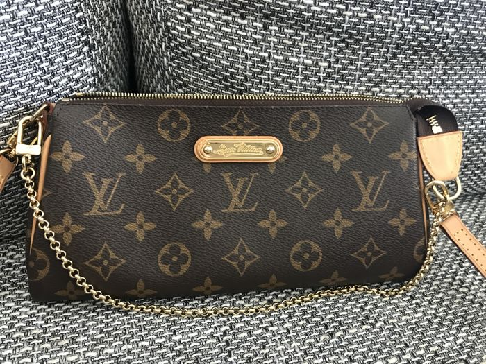 9afc3531499 Louis Vuitton - Eva clutch bag with shoulder strap - Catawiki
