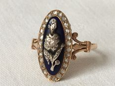Antique 14 kt gold ring with rose cut diamonds on blue glass.
