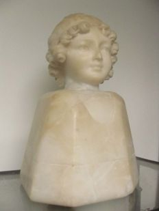 "Alabaster children's head on ""decorated"" plinth with buttons"