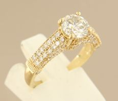 14k yellow gold ring with solitaire 1.10 ct brilliant cut diamond and 76 smaller diamonds, size 16.5 (52)