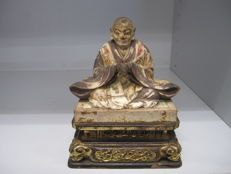 Votive wooden polychrome statue of sitting Buddhist monk – Japan – early 20th century