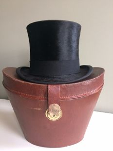 Leather hat box with top hat, early 20th century