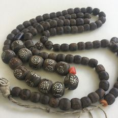 Long strand Antique black coral prayer beads with silver inlay