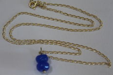Ladies' 18 kt/750 gold necklace with pendant with two sapphires measuring 8 x 5 mm