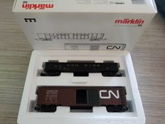 Märklin H0 - 4859 - 2-Piece carriage set with Boxcar and Gondola of the Alaska Railroad Canadian National