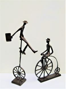 Two bronze cyclists
