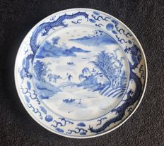 Beautiful plate with an image of a man with an ox on a bridge - China - 19th century