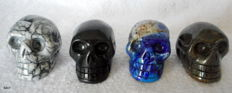4 skulls made of semi-precious gemstones - Man-made Amber, Lapis Lazuli, Pinolite and Antrofolite 45 to 50 x 40 mm -280 g (4)