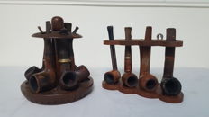 Collection of 10 pipes with wooden support