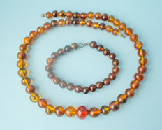 Translucent vintage Amber set of necklace and bracelet in green, yellow, blueish colors fluorescent beaded, 51 gram