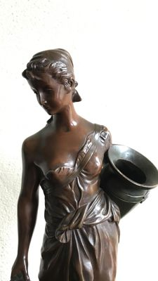 Edouard Drouot (1859-1945) - a bronze water carrier with 2 jars - France - early 20th century